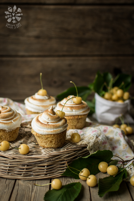 White cherry muffins with meringue frosting